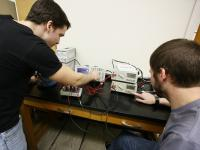 Students in and advanced physics lab