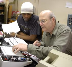 Professor working with students in the lab