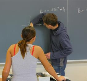 Professor writing on the chalkboard