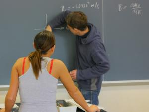 Professor demonstrating on the chalkboard